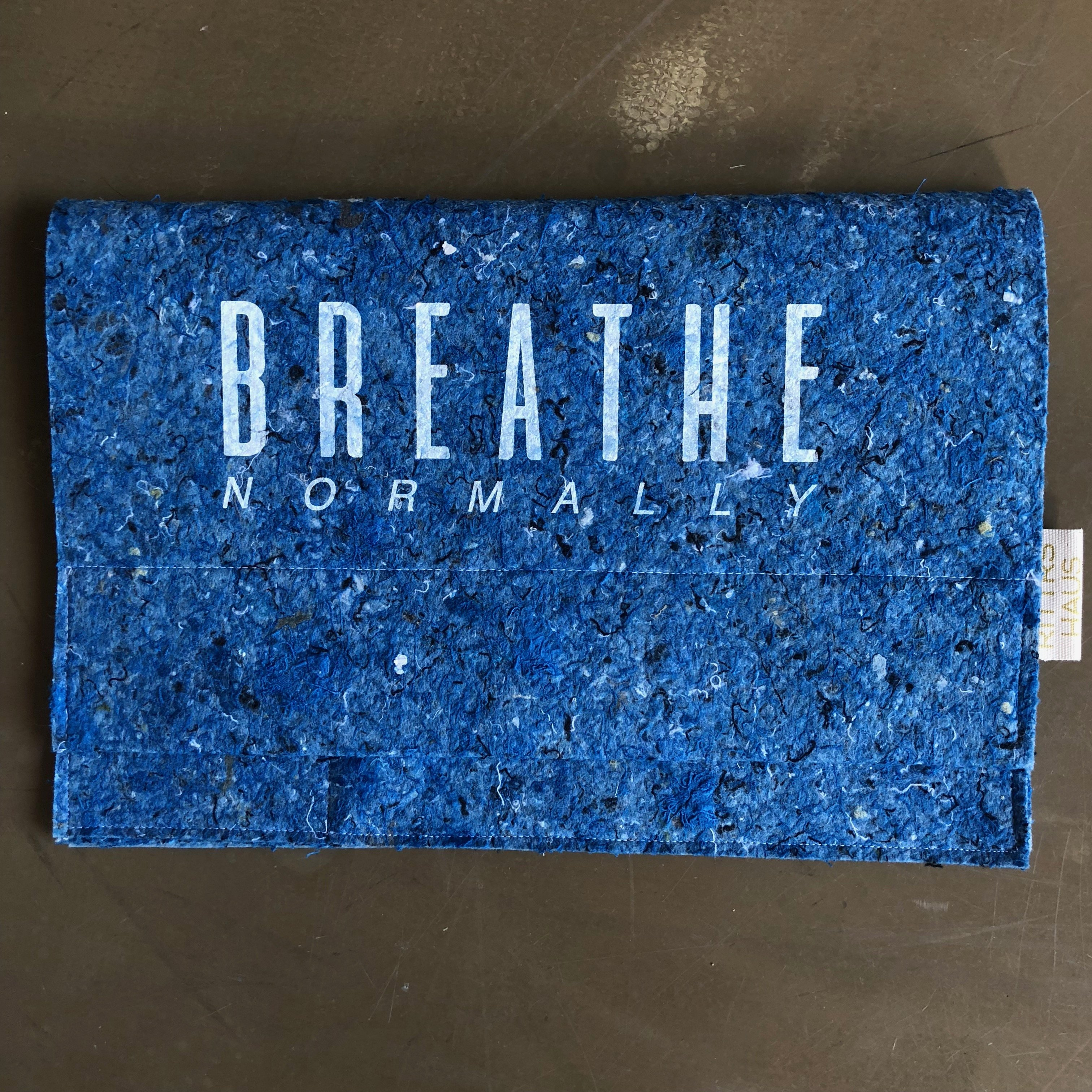 LAPTOP COVER, Breathe Normally (print on the front) from RITTRSHAUS