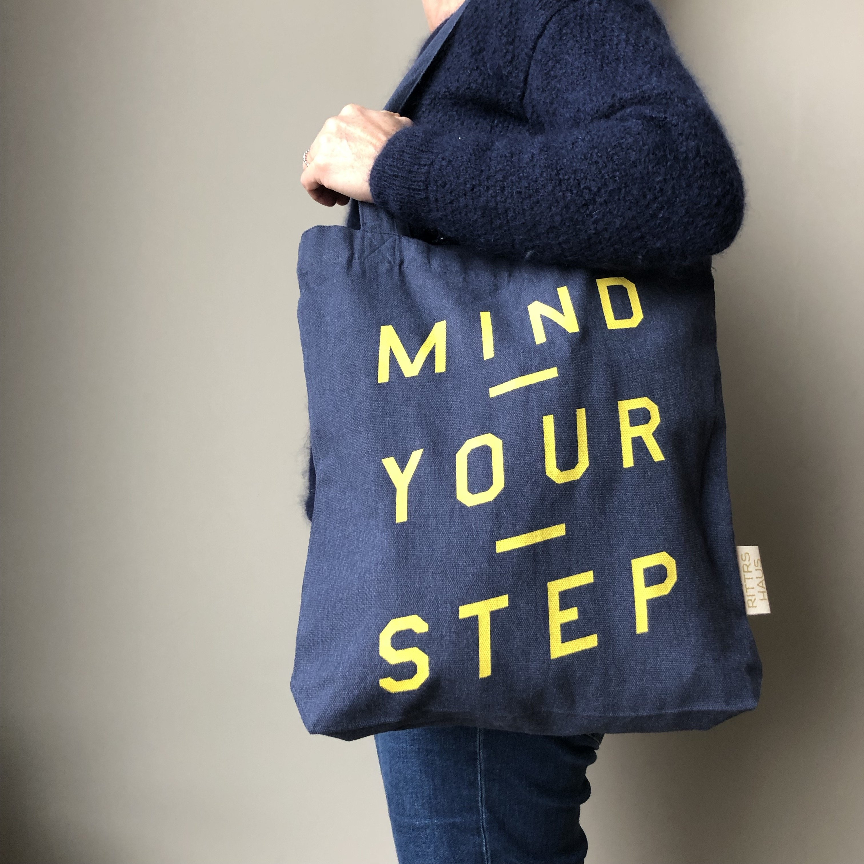 DENIM BLUE, Unisex TOTE BAG, Mind Your Step. from RITTRSHAUS